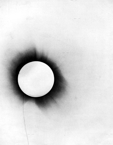 "Negative of the 1919 solar eclipse taken from the report of Sir Arthur Eddington with the title ""A Determination of the Deflection of Light by the Sun's Gravitational Field, from Observations Made at the Total Eclipse of May 29, 1919"". Credit: Wikimedia Commons"