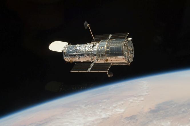 The Hubble Space Telescope in orbit around the Earth.  Credit:  NASA