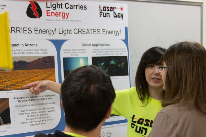 Stephanie Guzman shows the Energy poster to visitors. Credit: SOCk