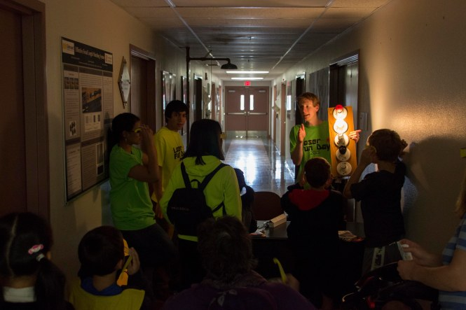 Visitors wear diffraction glasses to learn about light spectrums. Credit: SOCk