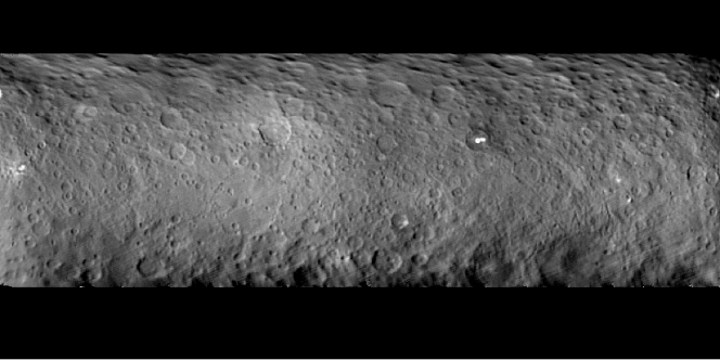 Dawn observed Ceres throughout a full nine-hour rotation of the dwarf planet, yielding this global mosaic of craters, mysterious bright spots and other intriguing features. The photos were taken on Feb. 19 from a distance of about 46,000 kilometers. Ceres has about 38 percent of the area of the continental United States. Credit: NASA/JPL-Caltech/UCLA/MPS/DLR/IDA