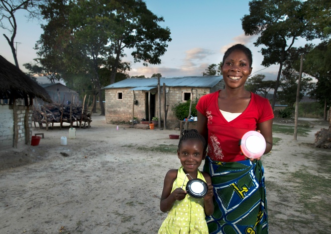 Mother and daughter holding SolarAid lights. Credit: Patrick Bentley/SolarAid