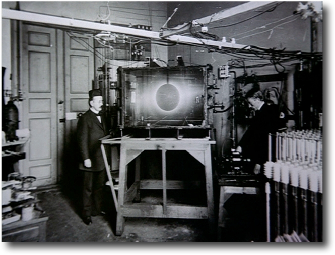 Kristian Birkeland with his Terella experiment. The metal sphere was his model Earth, while the vacuum glass container was space. When Birkeland sent particles toward the sphere, the Polar Regions glowed.  Credit: University of Oslo.