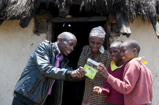 Gideon Langat delivering solar lights to rural house, Bomet county, Kenya. Credit: Corrie Wingate.