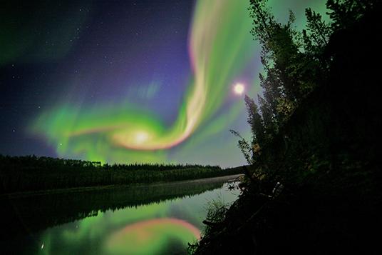 An aurora shines over Whitehorse, Yukon, U.S. Credit: David Cartier, Sr.