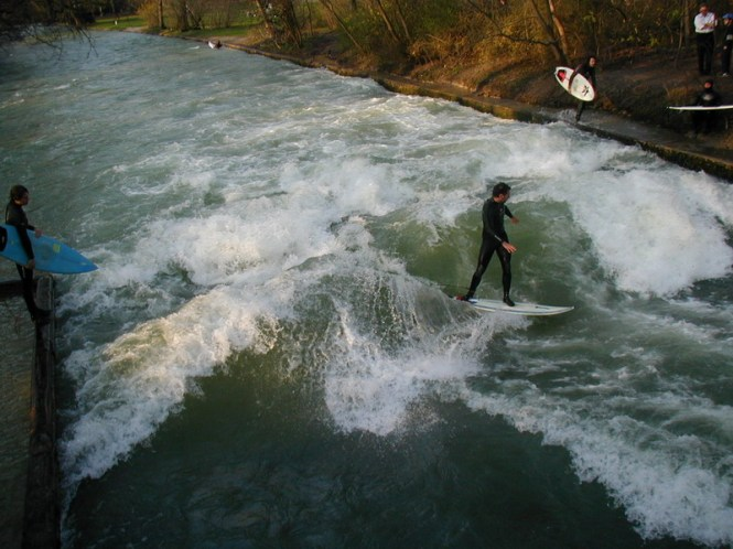 Surfing a standing wave on the Eisbach in Munihc, Germany. Credit: Wikimedia Commons.