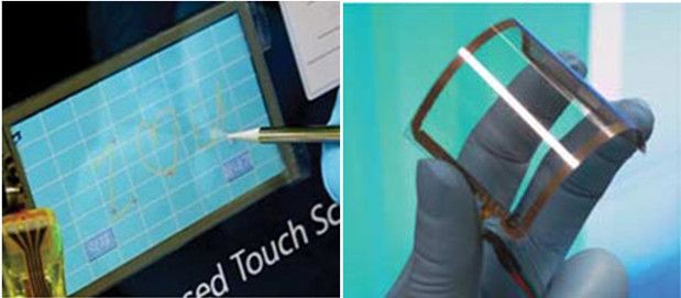 Researchers have created a flexible graphene sheet with silver electrodes printed on it (right) that can be used as a touch-screen when connected to control software on a computer (left). Credit: Nature Nanotechnology.
