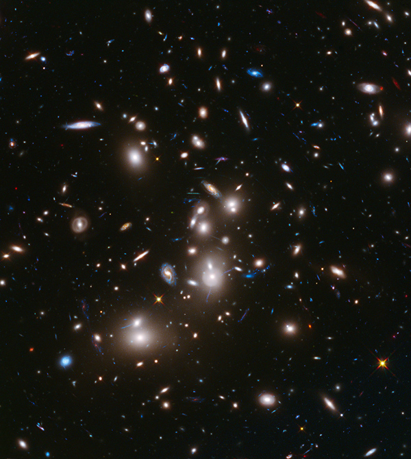 NASA Hubble Space Telescope image of massive cluster of galaxies, Abell 2744. Image credit: NASA/ESA/STScI.