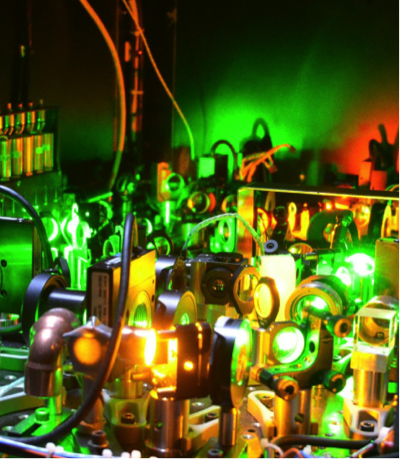 Optical components of the NASA Langley High-Spectral Resolution Lidar (HSRL) illuminated by laser light. Credit: NASA/A. Nehrir.