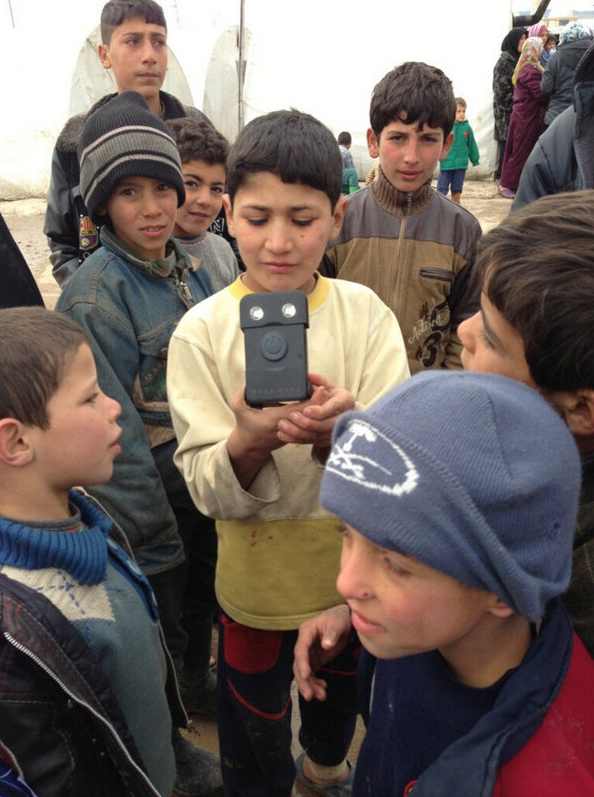 """Syrian refugees with the WakaWaka Power"". Credit: WakaWaka."