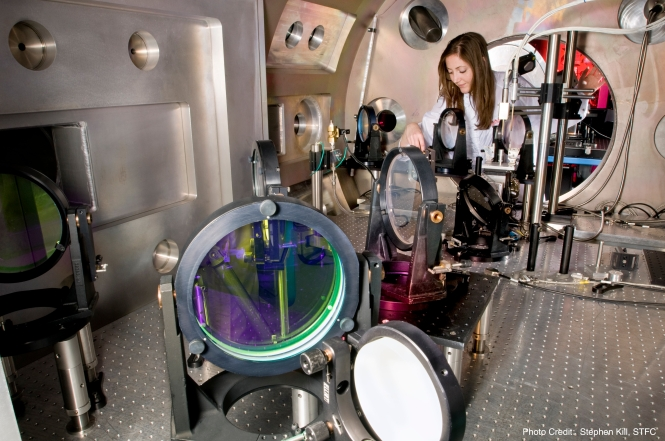 A team of researchers used Central Laser Facilities, CLF, Target Area West, TAW, to investigate the turbulent flow of inter-colliding plasmas in an ambient background – laboratory based astrophysics, experiments at STFC's Rutherford Appleton Laboratory, 29th May 2012. Image shows Jena Meinecke, Oxford University, adjusting optics in the TAW target chamber. Credit: Stephen Kill / STFC.