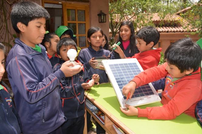 """Students from the school """"Fundación Niños del Arco Iris"""" building the solar system. Credit: Fundación Niños del Arco Iris."""