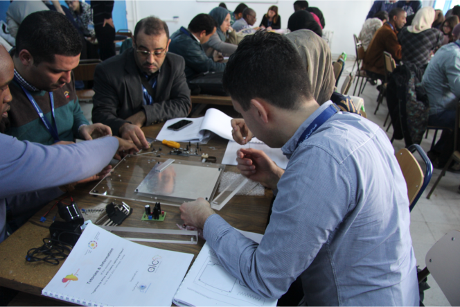 Tunisia March 2015 - Lighting UP Africa workshop participants in a hands-on training session. Organized by the Optical Society of Tunisia.