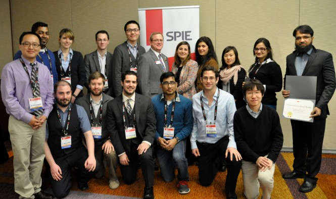 H. Philip Stahl with Physics PhD students at SPIE Photonics West. Credit: SPIE.